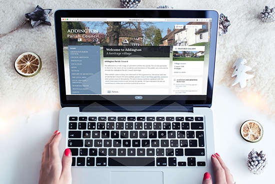 Addington Parish Council website screenshot on a laptop