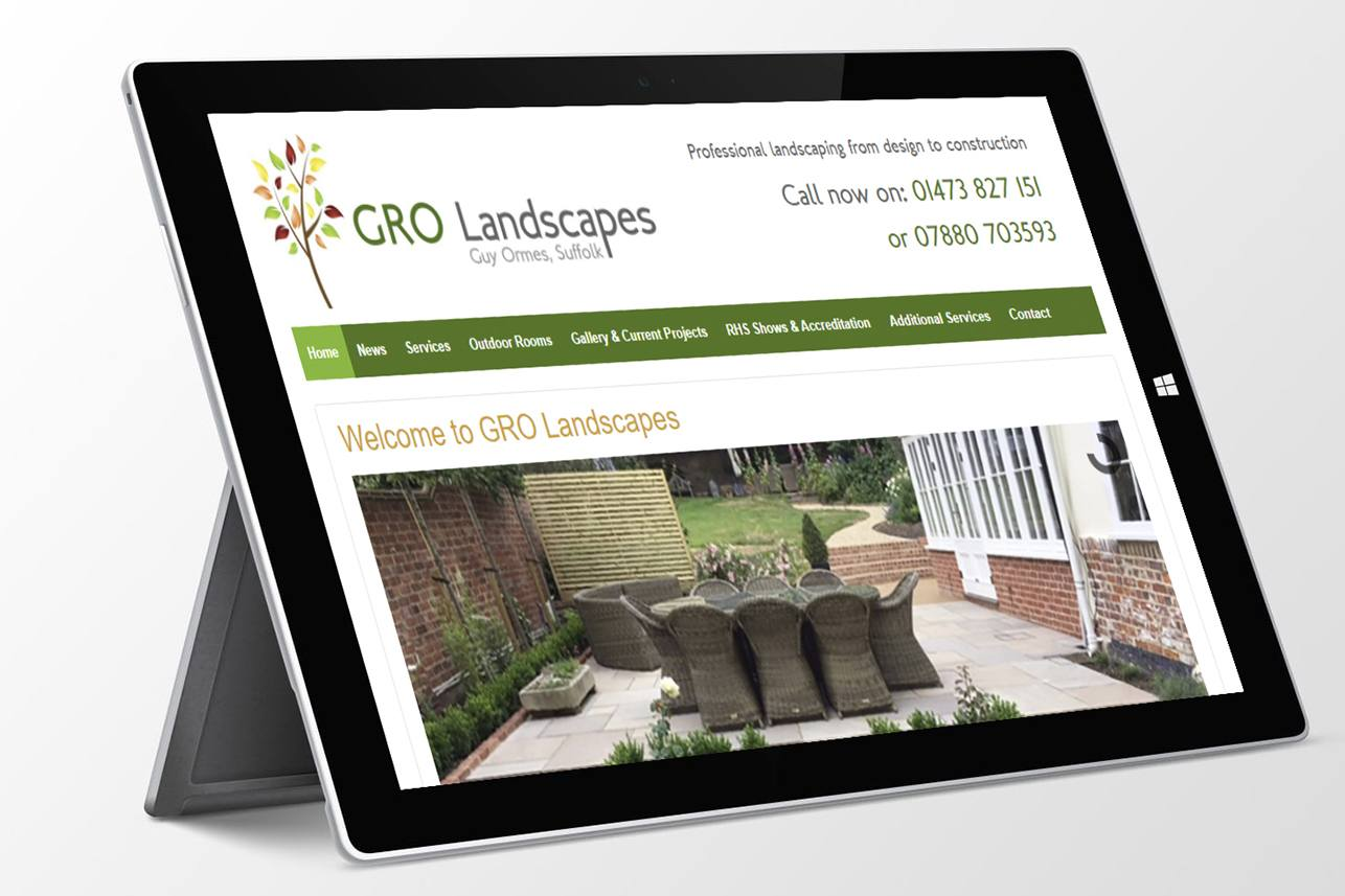 GRO Landscapes website screenshot displayed on a surface laptop